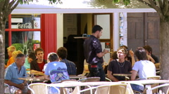 Cafe patrons - Cour du Chateau in central Chambery France Stock Footage