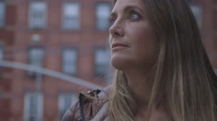 Close up of a pretty, middle aged woman against the background of a Brooklyn Stock Footage
