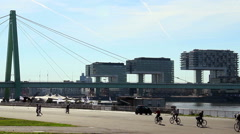 City quay river side timelapse, people cars bridge traffic sunny Stock Footage