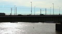 Silhouette city bridge, tram people car traffic week end holiday Stock Footage