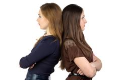 Photo of two women back-to-back - stock photo