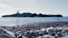 from coast to coast. small island with a light tower house. seashore landscape - stock footage