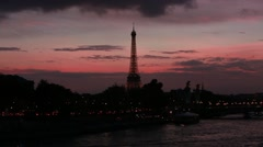 The illuminated Eiffel Tower in the night in Paris, France. Stock Footage