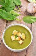 spinach soup with dried crusts - stock photo