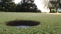 Golf Flag into hole Stock Footage