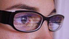 Futuristic info data on glasses women eyes close up Stock Footage