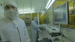 Workers in a Semiconductor manufacturing plant Stock Footage
