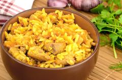 pilaf in a brown bowl - stock photo