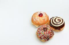 Hanukkah doughnut and spinning top - Traditional jewish holiday food and toy. - stock photo