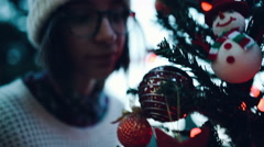 Handheld shot of girl checking Christmas decorations - stock footage