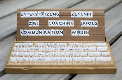 "german words: ""unterstützung, coaching, erfolg..."" (support, future,goals, c - stock photo"
