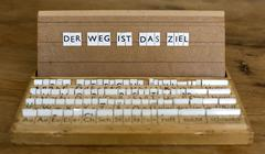 "text: ""der weg ist das ziel"" (the journey is the destination) - stock photo"