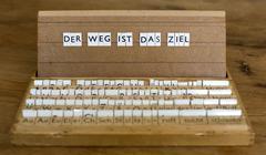 """Text: """"der weg ist das ziel"""" (the journey is the destination) Stock Photos"""