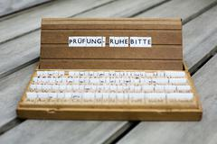 "german text: ""prüfung-ruhe bitte"" (exam-be quiet please) - stock photo"