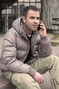 man outside on the phone - stock photo