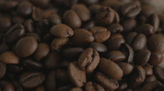 Roasted coffee beans. Falling coffee beans. Close-up. Stock Footage