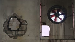 Old fan in  wall of an abandoned factory Stock Footage