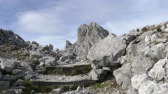 Summit cross on mountain top with stairs in foreground Stock Footage