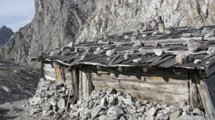Close-up of alpine cabin with climbing route in background  Stock Footage