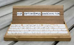 "text: ""auf optimismus umschalten"" (change to optimism) - stock photo"