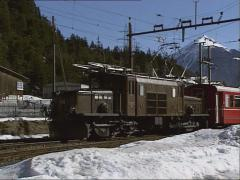 crocodile locomotive #412 of the Rhaetian Railway arrival at Surava station - stock footage