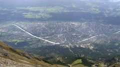 Look down to Innsbruck city from mountain top Stock Footage