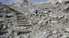 Alpine wooden stairs build into rocks on hiking trail Stock Footage
