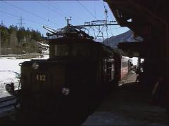 crocodile locomotive #412 Rhaetian Railway approaching Surava station - stock footage