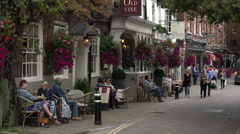 People sit at pub, great minster street, winchester, england Stock Footage