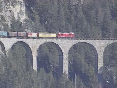 Freight train crossing the Landwasser Viaduct, part of the Albula Railway Stock Footage