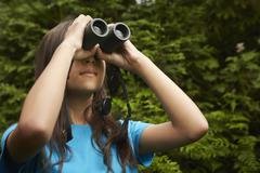 A young girl with bird watching binoculars. Stock Photos