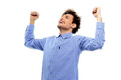 Cheerful man with raised hands up on a white background Stock Photos