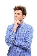 portrait of a young pensive man isolated on a white background - stock photo