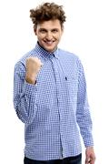 portrait of excited young man clenching fists - stock photo