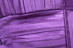 pleats, tucks and folds in scatter cushion fabric - stock photo
