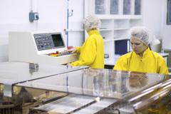 Pharmaceutical Manufacturing Technicians on the Production Line Kuvituskuvat