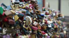 Love locks on a bridge, lovers padlocks hanging enormous amount, click for HD Stock Footage