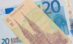euro - dinar - better before or after - stock photo