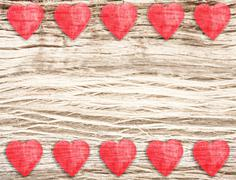 wooden hearts on timbered background, space for text. - stock photo