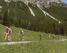 1991 Tour de Suisse: group of racing cyclist whiz past on a narrow road Stock Footage