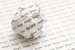 Crumpled paper ball with words hope Stock Photos