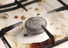Burner of old dirty gas cooker Stock Photos
