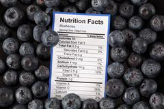 Nutrition facts of blueberries Stock Photos