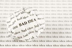 Crumpled paper ball with words bad idea Stock Photos