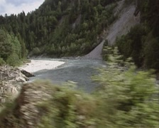 Vehicle shot from Glacier Express, passing Ruinaulta or Rhine Valley Stock Footage