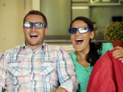 Happy, excited couple watching 3D movie on sofa at home NTSC Stock Footage