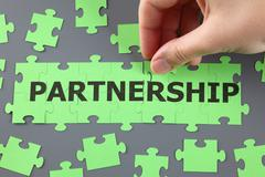 Partnership puzzle Stock Photos