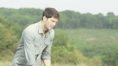 Stranded man with broken down car looks under the bonnet - stock footage