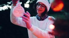 Handheld shot of girl holding Christmas decoration Stock Footage
