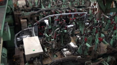 Robots weld car parts in production line at factory Stock Footage